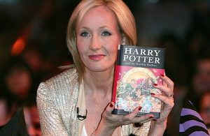 JK Rowling holding book
