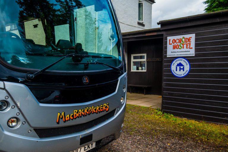 MacBackpackers Bus outside Lochside Hostel